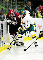 24 November 2009: University of Vermont Catamount forward Justin Milo, a Junior from Edina, MN, works to keep the puck from University of Massachusetts Minuteman forward James Marcou, a Junior from King Park, NY at Gutterson Fieldhouse in Burlington, Vermont. The Minutemen defeated the Catamounts 6-2. Mandatory Credit: Ed Wolfstein Photo
