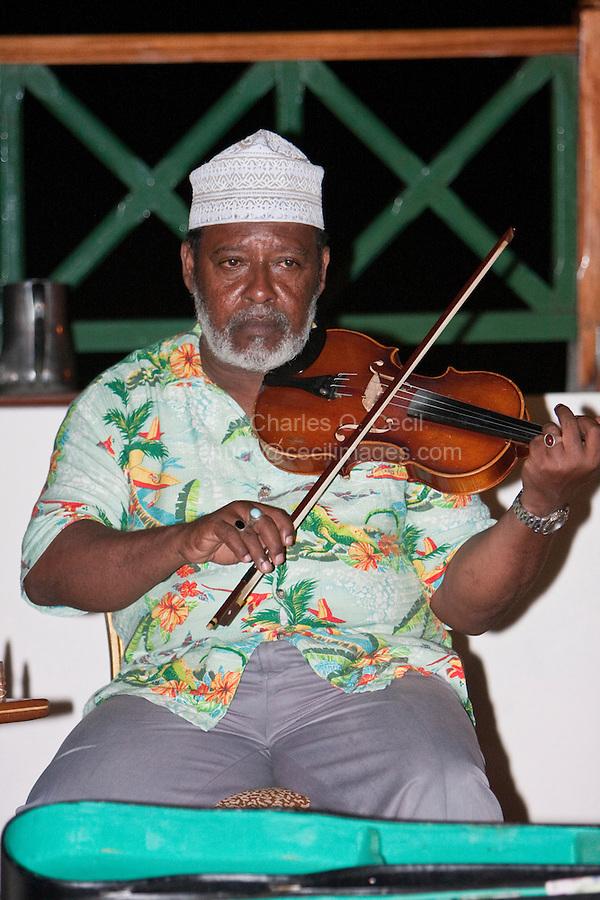 Zanzibar, Tanzania.  Dr. Muhammad Ilyas, Director of Twinking Star Taarab Musical Group, a part of the Nadi Akhwan Safaa.