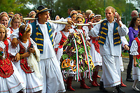 People carrying the wine bell dressed in tradtional Hungarian costume celebrating the wine festival - Badascony, Hungary