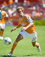 Houston Dynamo midfielder Stuart Holden (22) advances the ball.  Houston Dynamo defeated Colorado Rapids 1-0 at Robertson Stadium in Houston, TX on April 19, 2009.