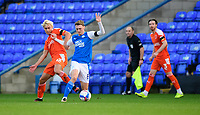 Blackpool's Kenny Dougall vies for possession with Peterborough United's Jack Taylor<br /> <br /> Photographer Chris Vaughan/CameraSport<br /> <br /> The EFL Sky Bet League One - Peterborough United v Blackpool - Saturday 21st November 2020 - London Road Stadium - Peterborough<br /> <br /> World Copyright © 2020 CameraSport. All rights reserved. 43 Linden Ave. Countesthorpe. Leicester. England. LE8 5PG - Tel: +44 (0) 116 277 4147 - admin@camerasport.com - www.camerasport.com