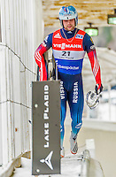 5 December 2014: Semen Pavlichenko, sliding for Russia, walks off the track after his first run, ending the day with combined 2-run time of 1:53.207 in the Men's Competition at the Viessmann Luge World Cup, at the Olympic Sports Track in Lake Placid, New York, USA. Mandatory Credit: Ed Wolfstein Photo *** RAW (NEF) Image File Available ***