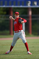 Philadelphia Phillies left fielder Mickey Moniak (15) throws the ball in during an Instructional League game against the Toronto Blue Jays on September 30, 2017 at the Carpenter Complex in Clearwater, Florida.  (Mike Janes/Four Seam Images)