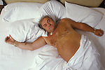 Les Dawson television personality comedian topless in bed for photo shoot for the BBC British Broadcasting Corporation. Jersey Chanel islands. 1990s, 1993, 90s,