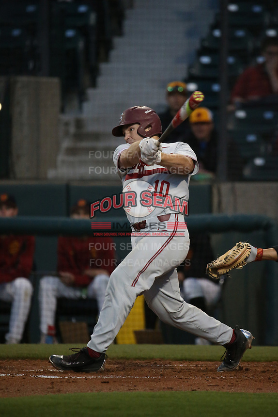 Maverick Handley (10) of the Stanford Cardinal bats against the Southern California Trojans at Dedeaux Field on April 6, 2017 in Los Angeles, California. Southern California defeated Stanford, 7-5. (Larry Goren/Four Seam Images)