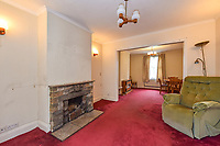 BNPS.co.uk (01202 558833)<br /> Pic: Homesestateagency/BNPS<br /> <br /> Pictured: The lounge room with a fireplace, leading to the dining room.<br /> <br /> A timewarp home that has been lived in by the same family for more than a century has gone on sale for the first time since being built.<br /> <br /> At the time the property was built, King Edward VII was on the throne and the First World War had not even started.<br /> <br /> The property is being sold for £550,000 under probate by the original builder's three grandchildren, who were born in the Victorian-style house.<br /> <br /> The two-bedroomed home is in the Surrey town of Haslemere and belonged to the Berry family, who decided to sell after the death of their parents, Freda and Leslie.