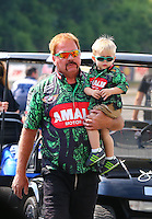 May 17, 2015; Commerce, GA, USA; NHRA top fuel driver Terry McMillen and son Cam McMillen during the Southern Nationals at Atlanta Dragway. Mandatory Credit: Mark J. Rebilas-USA TODAY Sports