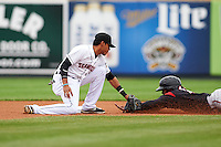 Erie Seawolves shortstop Harold Castro (1) tags Rando Moreno (17) sliding into second during a game against the Richmond Flying Squirrels on May 19, 2015 at Jerry Uht Park in Erie, Pennsylvania.  Richmond defeated Erie 8-5.  (Mike Janes/Four Seam Images)