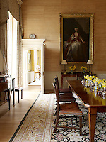 The low-key family dining room is in stark contrast to the State Dining Room, yet still furnished in a formal and traditional manner