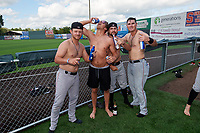 Batavia Muckdogs (L-R) Dustin Skelton, Kobie Taylor, Harrison DiNicola, and Nic Ready celebrate after clinching the Pinckney Division Title during a NY-Penn League game against the Auburn Doubledays on September 2, 2019 at Falcon Park in Auburn, New York.  Batavia defeated Auburn 7-0 to clinch the Pinckney Division Title.  (Mike Janes/Four Seam Images)