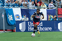 FOXBOROUGH, MA - JUNE 23: DeJuan Jones #24 of New England Revolution brings the ball forward during a game between New York Red Bulls and New England Revolution at Gillette Stadium on June 23, 2021 in Foxborough, Massachusetts.