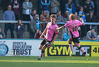 Shaun Brisley of Northampton Town celebrates his goal making it 3-1 during the Sky Bet League 2 match between Wycombe Wanderers and Northampton Town at Adams Park, High Wycombe, England on 3 October 2015. Photo by Andy Rowland.