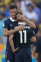 Olivier Giroud of France consoles Antoine Griezmann after defeat