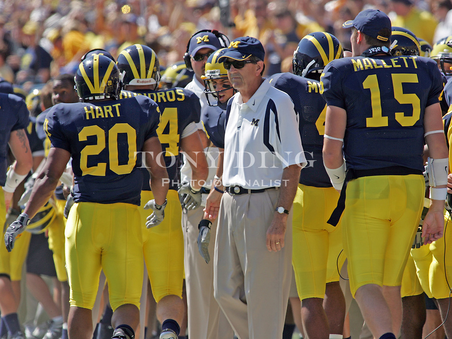 1 September 2007: Michigan running back Mike Hart (20) is taken out of the game by head coach Lloyd Carr, center, in the 2007 college football season opener game between the Michigan Wolverines and the Appalachian State Mountaineers at Michigan Stadium in Ann Arbor, MI. No. 5 ranked Michigan was upset 32-34.