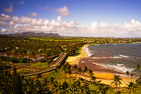 "Aerial view from above the Hilton Resort looking north at the ""Coconut Coast"" over the Wailua River, Wailua and Kapa'a, Kaua'i."