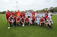 Pictured: Both teams pose for a picture after the game. Tuesday 06 May 2014<br /> Re: Members of the local press play football against Swansea City FC coaches and members of staff at the Club's training ground in Fairwood, south Wales.