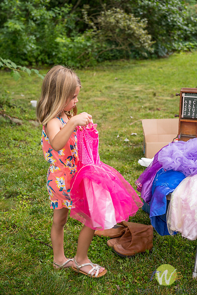 Duques yard sale. Child with party dress and costume for sale.
