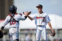 Rochester Red Wings pitcher Cody Stashak (53) and catcher Tomas Telis (18) celebrate closing out an International League game against the Scranton/Wilkes-Barre RailRiders on June 25, 2019 at Frontier Field in Rochester, New York.  Rochester defeated Scranton 10-9.  (Mike Janes/Four Seam Images)