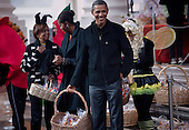 United States President Barack Obama waits with first lady Michelle Obama and her mother Marian Robinson to greet trick or treaters at the White House in Washington, D.C., Saturday, October 29, 2011.  The President and first lady hosted military families and other trick or treaters for a Halloween party. .Credit: Brendan Smialowski / Pool via CNP