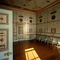 The chairs which line the Etruscan Dressing Room at Osterley Park were designed by Robert Adam to compliment Pietro Mario Borgnis's work which decorates the walls and ceiling