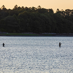 Two women fishing in Casco Bay near Martin Point in Portland, Maine.