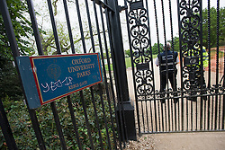 © London News Pictures. 24/05/2015. London, UK. Police guard the entrance to Oxford University Parks in Oxford City centre, where they are currently searching for 21 year old Jed Allen who is wanted in connection with the deaths of a man, a woman and a girl, found at a property in Didcot,  Oxfordshire.. Photo credit: Ben Cawthra/LNP