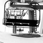 A lone skier rides the AV lift a JHMR.