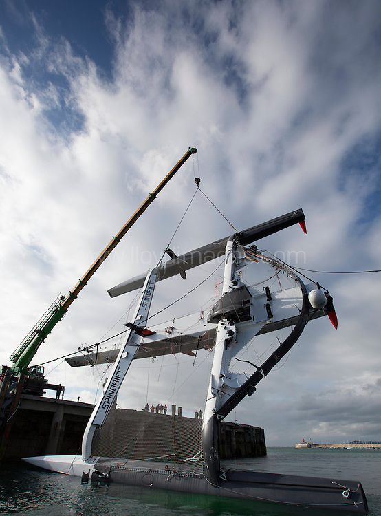 La Route des Princess. Dun Laoghaire.Dublin.<br /> Pictures of the of the Spindrift MOD70 being lifted and righted after capsizing during todays In-Port Race<br /> Credit: Lloyd Images