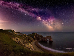© Licensed to London News Pictures. 16/6/2018. Lulworth, UK. A long exposure highlights The Milky Way over Durdle Daw at Lulworth in Dorset. Photo credit: Peter Scott/LNP