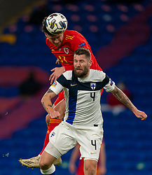 CARDIFF, WALES - Wednesday, November 18, 2020: Wales' Kieffer Moore (L) challenges for a header with Finland's Joona Toivio during the UEFA Nations League Group Stage League B Group 4 match between Wales and Finland at the Cardiff City Stadium. Wales won 3-1 and finished top of Group 4, winning promotion to League A. (Pic by David Rawcliffe/Propaganda)