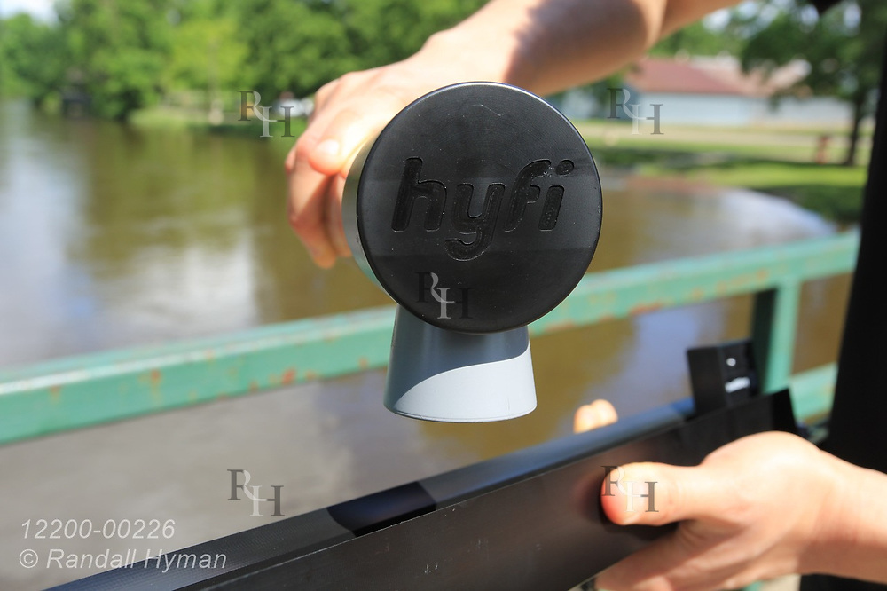 Close-up view of Hyfi wireless water-level sensor over the flooded Shiawassee River at Corunna, Michigan.