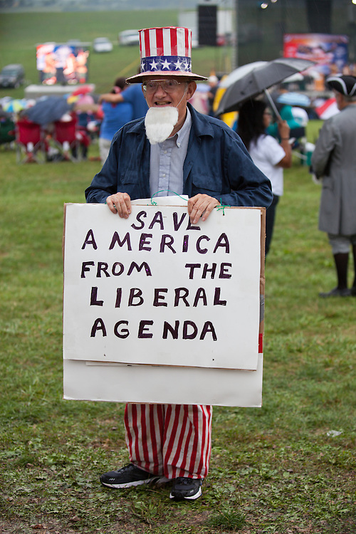 Man dressed as Uncle Sam at the Take Back America Tea Party Rally in Indianola Iowa on September 3, 2011, with headliner former Alaskan Governor Sarah Palin, wait for her speech in the rain. About 2000 people came out to here Palin's speech which sharply criticized President Obama and the status quo. She did not declare herself a candidate but did not rule it out before she heading  to New Hampshire to headline a  Tea Party Express event.