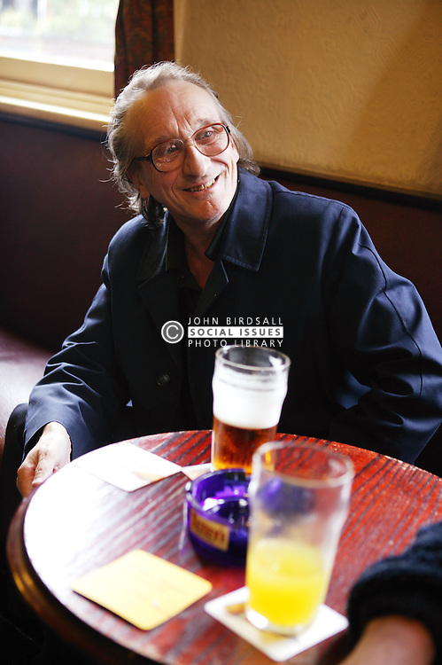 Woman having a drink in the pub,