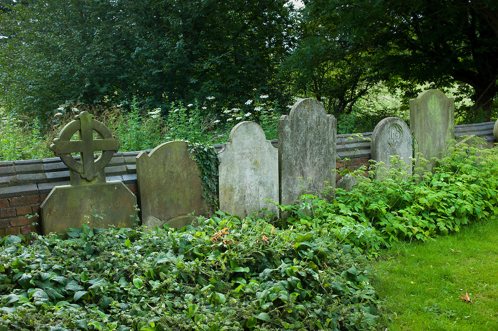 Headstones in graveyard of St Mary the Virgin Church, Harefield, Middlesex, UK