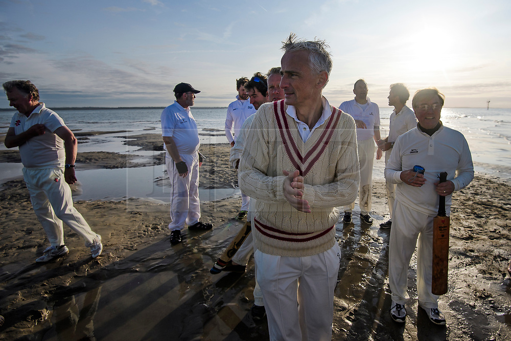 © Licensed to London News Pictures. 24/08/2017. Solent, UK. Players wait to play. Teams take part in the Brambles Bank Cricket Match in the middle of The Solent strait on August 24, 2017. The annual cricket match between the Royal Southern Yacht Club and The Island Sailing Club, takes place on a sandbank which appears for 30 minutes at lowest tide. The game lasts until the tide returns. Photo credit: Ben Cawthra/LNP
