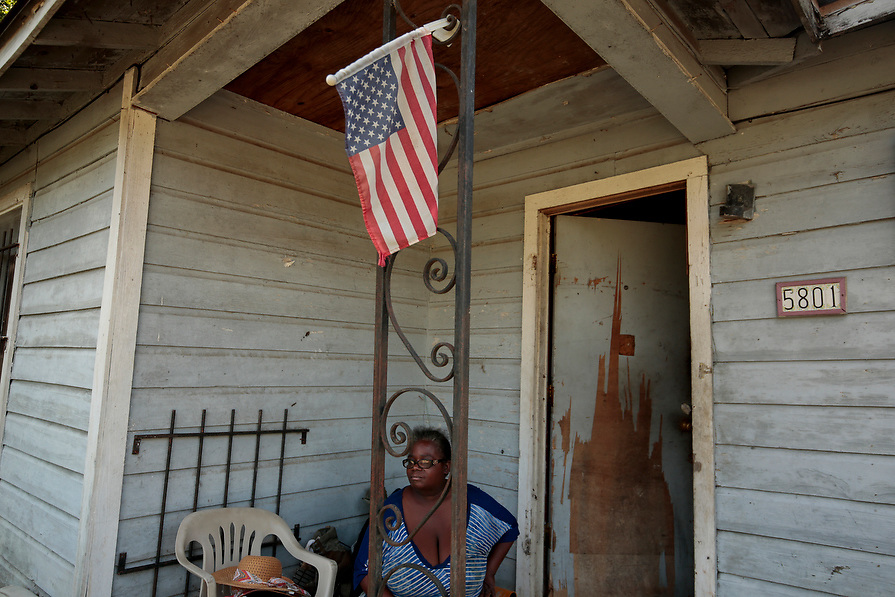 """""""Im just praying and hoping I can survive until I get out of this situation,"""" said Francile Lovings, 52, as she sits on her front porch to avoid the odor of mold and mildew in her home during the aftermath of tropical storm Harvey in Acres Homes, Houston, Texas, U.S. September 10, 2017. Lovings, who is waiting for assistance from FEMA, is still sleeping in the home although it doesn't have electricity and the mold gets worst everyday."""