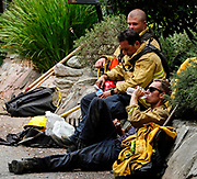 Firefighters rest during a brush fire in Burbank, California, the United States on September 3, 2017. More than 1,000 firefighters battling what the mayor had called the biggest brush fire in the city of Los Angeles history.  (Xinhua/Zhao Hanrong)(Photo by Ringo Chiu)<br /> <br /> Usage Notes: This content is intended for editorial use only. For other uses, additional clearances may be required.