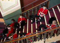© Licensed to London News Pictures. 07/11/2014.  London. Soldiers wait around in the foyer of the Royal Albert Hall as they prepare to rehearse before todays Festival of Remembrance.  Photo credit : Alison Baskerville/LNP