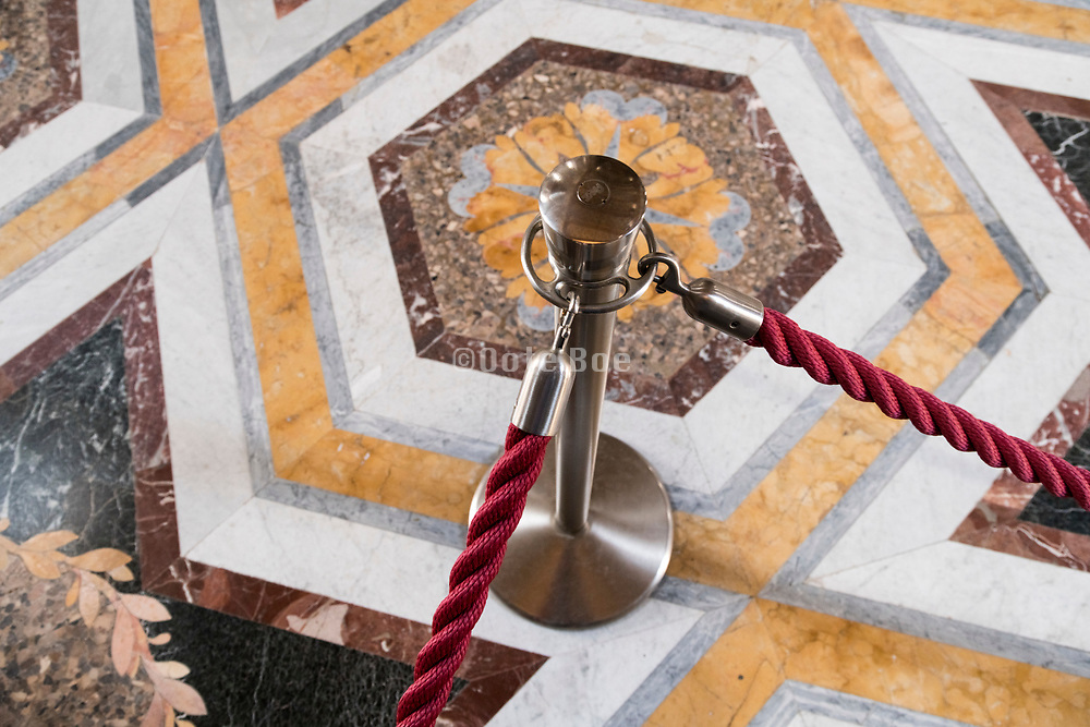 elegant marble floor protected by red rope in Palazzo Reale Caserta Italy