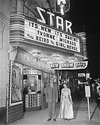 """Y-540416-1. """"Keiko (dancer) & theatre manager for Mossman April 16, 1954"""" Star Theatre Marquee. NW 6th between Burnside & Couch."""