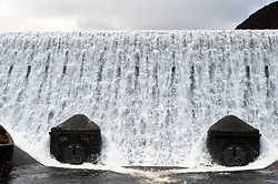 © Licensed to London News Pictures. 06/01/2018. Elan Valley Reservoirs, Powys, Wales, UK.  Water rages over the Caban Coch dam near Rhayader, Powys, Wales. The Elan Valley reservoir complex has been replenished after heavy rainfall from Storm Eleanor and melting snow which fell in December 2017. Birmingham's Frankley reservoir is supplied by Elan Valley reservoirs on a gravity feed over a distance of 73 miles (117 Km.) Photo credit: Graham M. Lawrence/LNP