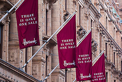 © Licensed to London News Pictures. 26/12/2013. London, UK. Flags advertising the Harrods Boxing Day sale are seen on the outside of the world famous department store as it begins its Boxing Day sale in London today (26/12/2013). Photo credit: Matt Cetti-Roberts/LNP