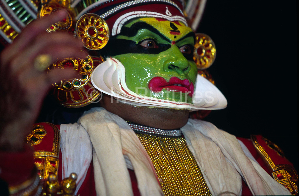 A Kathakali performance at the Kerala Kalamandalam, Kerala, India.The Kalamandalam was founded in 1930 to preserve the cultural traditions of Kathakali, the stylised dance drama of Kerala. Kathakali is the classical dance-drama of Kerala, South India, which dates from the 17th century and is rooted in Hindu mythology. Kathakali is a unique combination of literature, music, painting, acting and dance performed by actors wearing extensive make up and elaborate costume who perform plays which retell in dance form stories from the Hindu epics