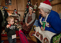 Liam shows off his new scarf to Gramma Pat and Gramma Cecile on his visit to the Chistmas Village on Thursday's opening night.  (Karen Bobotas/for the Laconia Daily Sun)