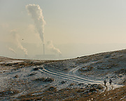 The expanding Baga Naran Ger district on the edge of Ulan Bator. Views on the coal-fired power plant.<br /> Mongolia