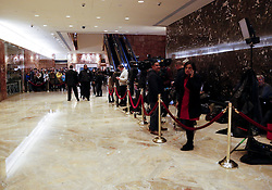 November 21, 2016 - New York, New York, United States of America - Journalists located behind the rope line on the right and tourists on the left wait to see personalities coming in and out the elevator, in the lobby of the Trump Tower, as United States President-elect Donald Trump is holds meetings on top floors of the building, November 21, 2016, in New York, New York..Credit: Aude Guerrucci / Pool via CNP (Credit Image: © Aude Guerrucci/CNP via ZUMA Wire)