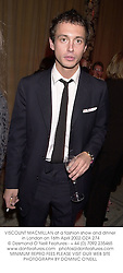 VISCOUNT MACMILLAN at a fashion show and dinner in London on 16th April 2002.OZA 274