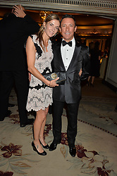FRANKIE DETTORI and his wife CATHERINE at the 26th Cartier Racing Awards held at The Dorchester, Park Lane, London on 8th November 2016.