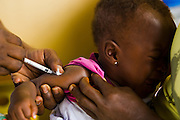 Nurse Rebecca Lartey vaccinates a child at the Osu Maternity Home in Accra, Ghana on Tuesday June 16, 2009.