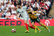 Adam Lallana of England dribbling and starting an attack during the FIFA World Cup Qualifier group stage match between England and Lithuania at Wembley Stadium, London, England on 26 March 2017. Photo by Matthew Redman.